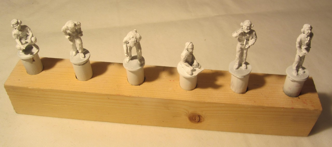 Figures primed and ready for painting.